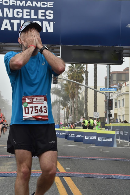 At the finish line of the 2016 Los Angeles Marathon after officially running the race